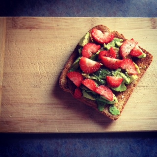 Healthy eating habits -sprouted grains toasted bread with avocado and strawberries